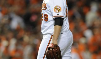 Baltimore Orioles pitcher Tommy Hunter reacts after giving up a three-run home run to Detroit Tigers' Miguel Cabrera in the ninth inning of a baseball game Tuesday, May 13, 2014, in Baltimore. The Tigers won 4-1. (AP Photo/Gail Burton)