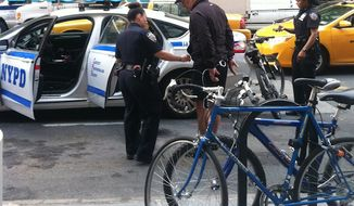 photo from InTouch weekly shows actor Alec Baldwin being arrested by NYPD officers.