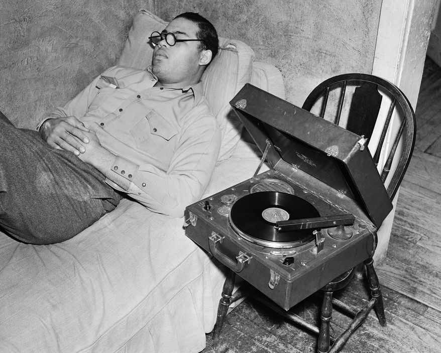 Heavyweight  boxing champion Joe Louis relaxes listening to music at his training camp at Pompton Lakes, N.J.,  January 12, 1939.    Louis will be meeting boxer John Henry Lewis for his next fight on                January 25, 1939.      (AP Photo/ Joe Caneva)