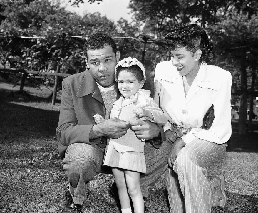 Little Jacqueline Louis and her mother, Marva Trotter, former wife of Joe Louis, pay a Father's Day visit to the heavyweight champion's training camp at Pompton Lakes, N.J., June 16, 1946.   Jacqueline gave Daddy a tie clasp featuring golf clubs instead of boxing gloves.    (AP Photo/ John Lindsay)