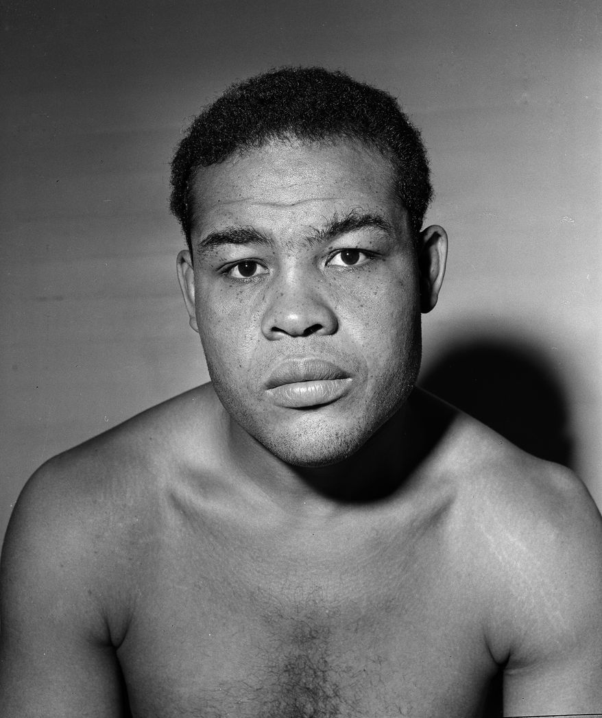 Heavyweight boxing champion Joe Louis is shown as he begins training for the 24th defense of the heavyweight boxing title on Nov. 5, 1947.  (AP Photo)