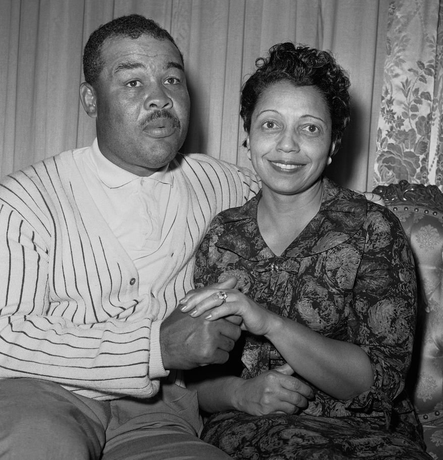 Former heavyweight King Joe Louis, 45, poses with his third wife as they revealed their six day old marriage at her home at Los Angeles on March 18, 1959. She is the former Mrs. Martha Jefferson, 46, a Los Angeles Criminal Attorney. They married secretly at Winterhaven, Calif. (AP Photo)