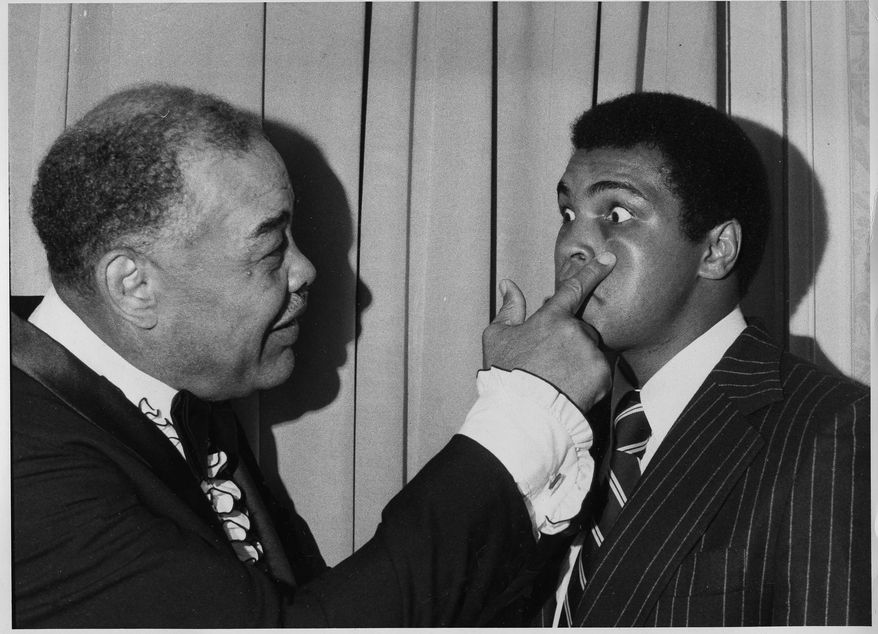 Former heavyweight champion Joe Louis, left, playfully jabs a finger under the eye of present champ Muhammad Ali, at the Boxing Writers Association's 50th Anniversary dinner in New York, May 19, 1975.  Ali was named Fighter of the Year and Louis was honored as boxing's Man of the Half Century.  (AP Photo)