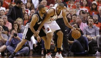 San Antonio Spurs' Tony Parker, left, guards Portland Trail Blazers' Nicolas Batum, right, in the first quarter during Game 4 of a Western Conference semifinal NBA basketball playoff series Monday, May 12, 2014, in Portland, Ore. (AP Photo/Rick Bowmer)