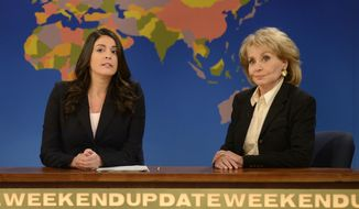 "This May 10, 2014 photo released by NBC shows cast member Cecily Strong, left, with TV personality Barbara Walters during an appearance on the ""Weekend Update"" segment of ""Saturday Night Live,"" in New York. (AP Photo/NBC, Dana Edelson)"