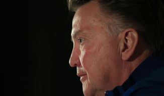 Louis van Gaal, coach of the Dutch national soccer team, listens to questions of journalists in a pre World Cup soccer tournament press conference, Tuesday, May 13, 2014, in Hoenderloo, east central Netherlands. Van Gaal said he would announce a preliminary 30-man squad later today. (AP Photo/Peter Dejong)