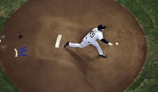 Pittsburgh Pirates starting pitcher Gerrit Cole throws during the first inning of a baseball game against the Milwaukee Brewers, Tuesday, May 13, 2014, in Milwaukee. (AP Photo/Morry Gash)