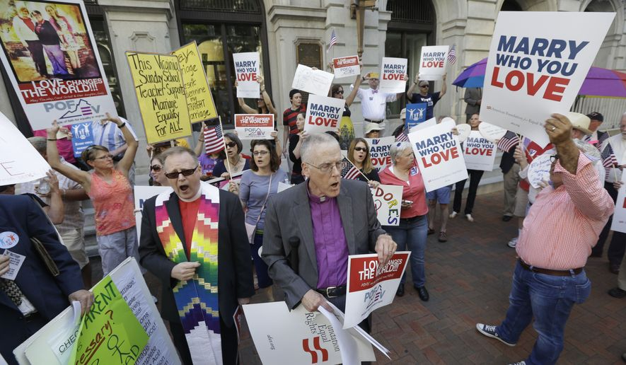 Supporters of gay marriage demonstrate outside the Federal Appeals Court in Richmond, Va., Tuesday, May 13, 2014.   The 4th U.S. Circuit Court of Appeals in Richmond is taking up the issue of gay marriage, with arguments scheduled on a ruling that the state's ban on such unions is unconstitutional.  (AP Photo/Steve Helber)