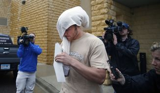 Former Minnesota quarterback Philip Nelson leaves the Blue Earth Co jail with a towel on his head after posting $20,000 bail in his assault case stemming from a fight outside a bar that left another former football player in critical condition with head injuries, in Mankato, Minn, Monday, May 12, 2014. Authorities say Nelson kicked Isaac Dallas Kolstad, 24, in the head after another man punched and knocked him to the ground early Sunday as bars were closing in Mankato.  (AP Photo/The Star Tribune, Richard Tsong-Taatarii)  MANDATORY CREDIT; ST. PAUL PIONEER PRESS OUT; MAGS OUT; TWIN CITIES TV OUT