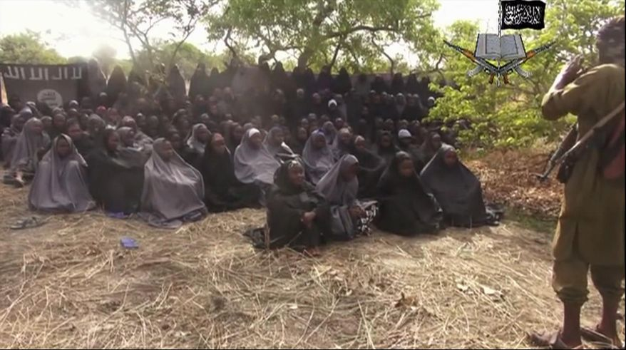 ** FILE ** This file photo taken from video by Nigeria's Boko Haram terrorist network, Monday, May 12, 2014, shows the missing girls alleged to be abducted April 14, from the northeastern town of Chibok. (AP Photo/File)