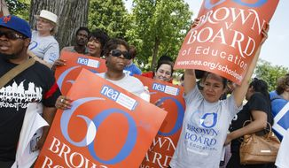 "Students, parents and educators rally at the Supreme Court in Washington, Tuesday, May 13, 2014, for the 60th anniversary Brown v. Board of Education decision that struck down the ""separate but equal"" concept established under Plessy v. Ferguson that kept schools segregated. (AP Photo)"