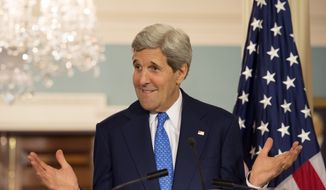 Secretary of State John Kerry reacts to a question during a joint press availability with Italy's Foreign Minister Federica Mogherini at the State Department in Washington, Tuesday, May 13, 2014. (AP Photo/Molly Riley)
