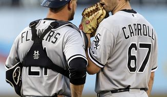 Chicago White Sox pitcher Scott Carroll, right, speaks with catcher Tyler Flowers in the first inning of a baseball game against the Oakland Athletics, Tuesday, May 13, 2014, in Oakland, Calif. (AP Photo)
