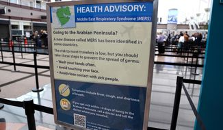 This May 14, 2014 image, provided by Denver International Airport, shows newly-erected signs warning travelers about he danger of the MERS virus, at Denver International Airport. MERS, or Middle East Respiratory Syndrome, is a respiratory illness that begins with flu-like fever and cough but can lead to shortness of breath, pneumonia and death. The airport says the signs were posted Wednesday, May 14, 2014 at all of its screening areas at the direction of the Centers for Disease Control. (AP Photo/Denver International Airport)