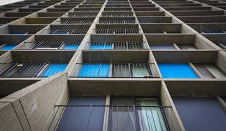In this photo taken May 13, 2014, shows a section of the Riverside Plaza apartments where a 15-month-old boy survived an 11-story fall from a balcony in Minneapolis. The child, Musa Dayib, suffered a broken spine and ribs as well as a concussion and a punctured lung. His relatives believe he slipped through the balcony's railing Sunday evening. (AP Photo/The Star Tribune, Renee Jones Schneider) MANDATORY CREDIT; ST. PAUL PIONEER PRESS OUT; MAGS OUT; TWIN CITIES TV OUT.