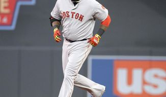 CORRECTS TO FOURTH INNING FROM SIXTH - Boston Red Sox David Ortiz (34), rounds second base after hitting a solo home run against Minnesota Twins pitcher Ricky Nolasco during the fourth inning of a baseball game in Minneapolis, Tuesday, May, 13, 2014. (AP Photo/Craig Lassig)