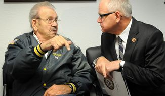 Rep. Tim Walz visits with veteran Virgil Marble, left, during a visit to the Mankato VA Outpatient Clinic in Mankato, Minn., on Wednesday, May 14, 2013. (AP Photo/The Mankato Free Press, John Cross)