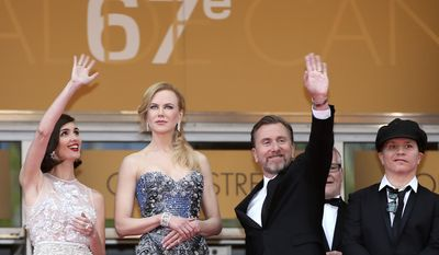 From left, actress Paz Vega, actress Nicole Kidman, actor Tim Roth and director Olivier Dahan stand at the top of the carpet during the opening ceremony and screening of Grace of Monaco at the 67th international film festival, Cannes, southern France, Wednesday, May 14, 2014. (AP Photo/Alastair Grant)