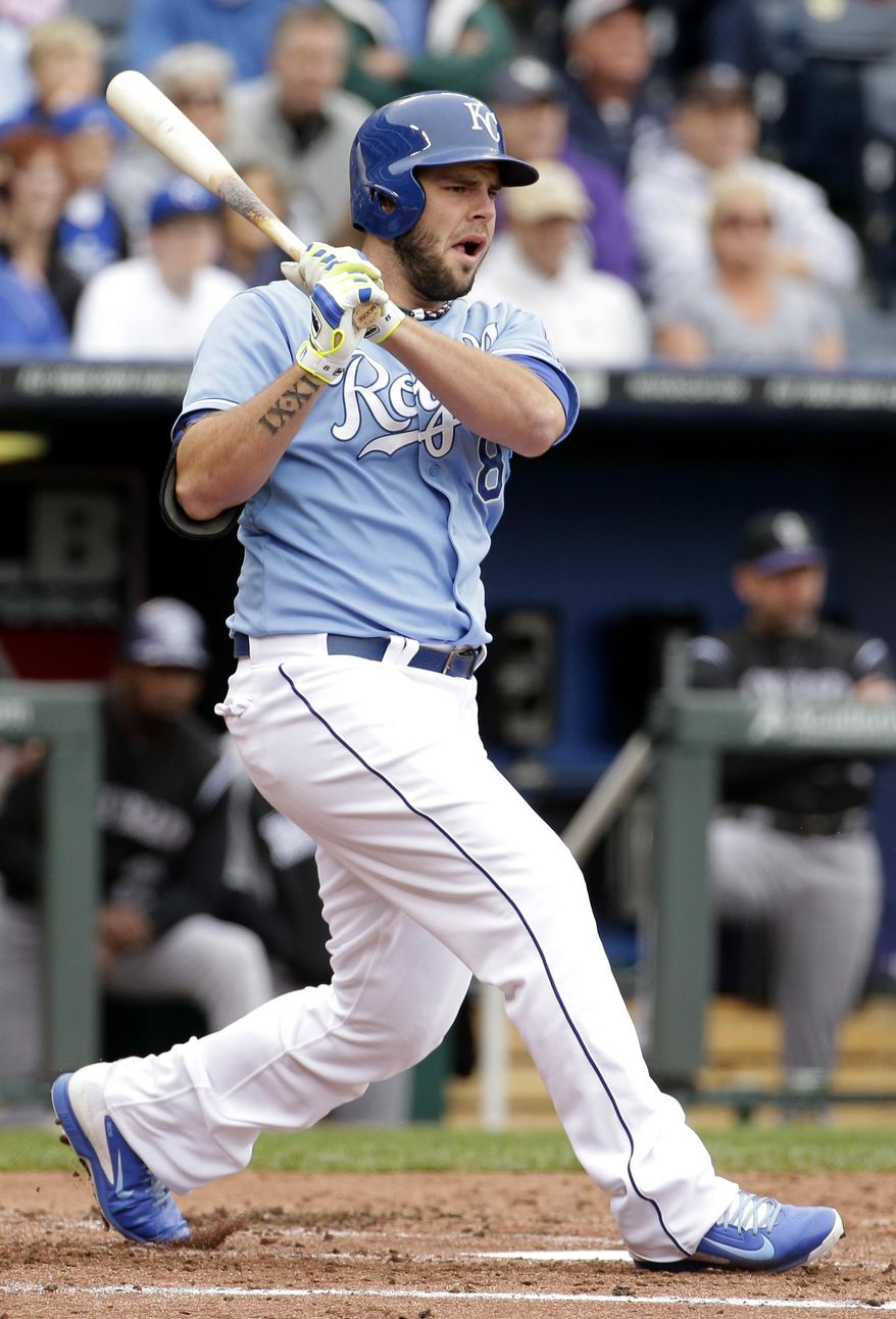 Kansas City Royals' Mike Moustakas hits a three-run double during the second inning of a baseball game against the Colorado Rockies Wednesday, May 14, 2014 in Kansas City, Mo. (AP Photo/Charlie Riedel)