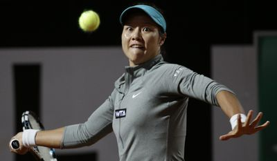 China's Na Li returns the ball to Australia's Casey Dellacqua at the Italian Open tennis tournament, in Rome, Tuesday, May 13, 2014. (AP Photo/Alessandra Tarantino)
