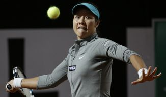 China's Na Li returns the ball to Australia's Casey Dellacqua at the Italian Open tennis tournament, in Rome, Tuesday, May 13, 2014. (AP Photo/Alessandra Tarantino)