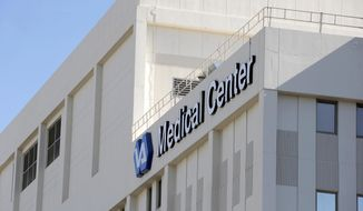 ** FILE ** The Phoenix VA Health Care Center in Phoenix, is seen in this Monday, April 28, 2014, file photo. A team of federal investigators swept into the city last month amid allegations of a disturbing cover-up at the veterans hospital, and began interviewing staff at the facility and poring over records, emails and electronic databases. (AP Photo/Ross D. Franklin)