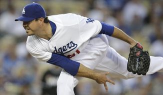 Los Angeles Dodgers starting pitcher Josh Beckett throws against the Miami Marlins during the third inning of a baseball game on Tuesday, May 13, 2014, in Los Angeles. (AP Photo)