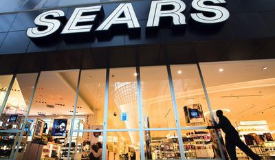 FILE - In this Oct, 29, 2013 file photo, the Sears store at Eaton Centre in Toronto opens its doors for business. Sears is considering selling its Canadian operations as the retailer continues with efforts to turnaround its business. Its stock rose more than 7 percent in premarket trading on Wednesday, May 14, 2014. (AP Photo/The Canadian Press, Frank Gunn, File)