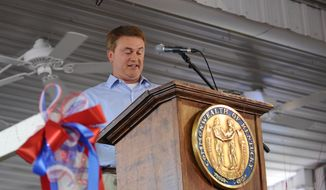 FILE - In this Saturday, Aug. 3, 2013, file photo, Kentucky Commissioner of Agriculture James Comer, R-Thompkinsville, speaks during the 133rd annual Fancy Farm picnic in Fancy Farm, Ky.  Kentucky's Agriculture Department has filed a lawsuit s Wednesday, May, 2014, seeking the release of imported hemp seeds being held up by federal officials. The state Agriculture Department wants to distribute the seeds for use in pilot projects that would be Kentucky's first hemp crop in decades. Holly Harris VonLuehrte , chief of staff to Comer, says federal officials wanted the state to apply for a permit.  (AP Photo/Stephen Lance Dennee)