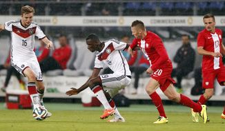 Germany's Christoph Kramer, from left, Germany's Antonio Ruediger and Poland's  Marcin Robak challenge for the ball during a friendly soccer match between Germany and Poland in Hamburg, Germany, Tuesday, May 13, 2014.  (AP Photo/Matthias Schrader)