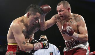 FILE - In this March 30, 2013 file photo, Mike Alvarado, right, exchanges punches with Brandon Rios during a WBO super lightweight title fight in Las Vegas. Alvadado is scheduled to fight Juan Manuel Marquez at the Forum in Inglewood, Calif., on Saturday, May 17. (AP Photo/Julie Jacobson, File)
