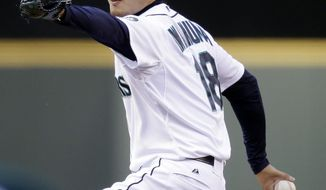 Seattle Mariners starting pitcher Hisashi Iwakuma throws against the Tampa Bay Rays in the first inning of a baseball game Tuesday, May 13, 2014, in Seattle. (AP Photo)