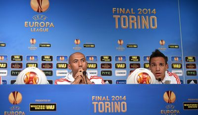 In this photo made available by Uefa, Benfica captain Luisao, left, and his teammate Rodrigo listens during a press conference ahead of tomorrow's final of the Europa League against Sevilla, at the Juventus stadium in Turin, Italy, Tuesday, May 13, 2014 ( AP Photo/Uefa, HO)