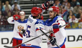 Russia forward Danis Zaripov, left and forward Viktor Tikhonov during the Group B preliminary round match between Russia and Kazakhstan at the Ice Hockey World Championship in Minsk, Belarus, Wednesday, May 14, 2014. (AP Photo/Darko Bandic)