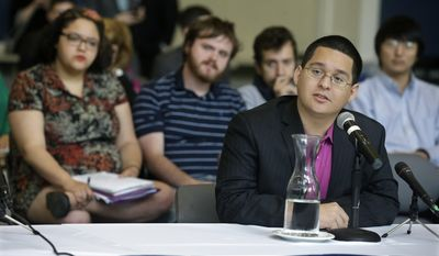 Giancarlo Tello, 24, of Bellville, N.J., who is living in this country illegally, addresses the New Jersey Assembly's Higher Education Committee in Ewing, N.J., Wednesday, May 14, 2014, as the committee visited The College of New Jersey campus to get input on affordability and other higher education issues. Tello told the committee a law adopted last year to allow people like him living in the country illegally to pay in-state tuition will allow him to return to Rutgers University next year but that the fact that they are ineligible for state financial aid is still keeping students out of college.(AP Photo/Mel Evans)