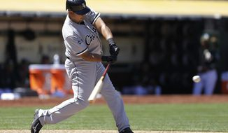Chicago White Sox's Jose Abreu swings on a three-run home run off Oakland Athletics' Luke Gregerson in the eighth inning of a baseball game Wednesday, May 14, 2014, in Oakland, Calif. (AP Photo)