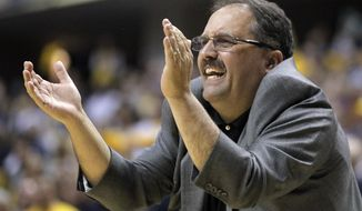FILE - In this April 8, 2012 file photo, Orlando Magic head coach Stan Van Gundy gestures in the second half of an NBA first-round playoff basketball game against the Indiana Pacers in Indianapolis. The Detroit Pistons say they have hired Stan Van Gundy as their coach and president of basketball operations. Owner Tom Gores said Wednesday, May 14, 2014, that Van Gundy is a proven winner and a teacher who can help shape the franchise. (AP Photo/Michael Conroy, File)