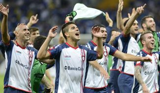 Argentina's San Lorenzo players, celebrate their victory over Brazil's Cruzeiro during a Copa Libertadores soccer match in Belo Horizonte, Brazil, Wednesday, May 14, 2014. San Lorenzo won with an aggregate score of 2-1.  (AP Photo/Eugenio Savio)