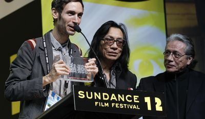"""FILE - This Jan. 28, 2012 file photo shows Swedish director Malik Bendjelloul, left, and documentary film subject Rodriguez, center, accepting the World Cinema Audience Award: Documentary for the film """"Searching for Sugar Man"""" as presenter Edward James Olmos, right, looks on during the 2012 Sundance Film Festival Awards Ceremony in Park City, Utah. Police in Sweden say Malik Bendjelloul has died. He was 36. Police spokeswoman Pia Glenvik said Bendjelloul died in Stockholm late Tuesday, May 13, 2014, but wouldn't specify the cause of death. (AP Photo/Danny Moloshok, FIle)"""