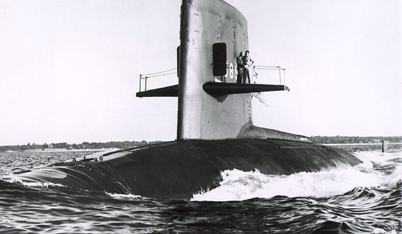 "The nuclear submarine USS Scorpion is seen in the Atlantic Ocean in 1968 - The nuclear attak submarine Scorpion which was reported overdue at sea by the Pentagon May 27, 1968. A defense department statement said the sub had been scheduled to return to Norfolk, Va., at 1 P.M. May 27 at the end of a routine training operation. The Scorpion was last heard from May 21, 1968. This June 27, 1960, Handout picture shows the ""USS Scorpion"" nuclear-powered attak submarine (SSN-589) at New London, Ct., USA during builders trials. Vice Admiral Hyman G. Rickover is standing on her sailplanes with another officer. (AP-Photo/ag/u.s. Navy-HO)    June 08, 2000"