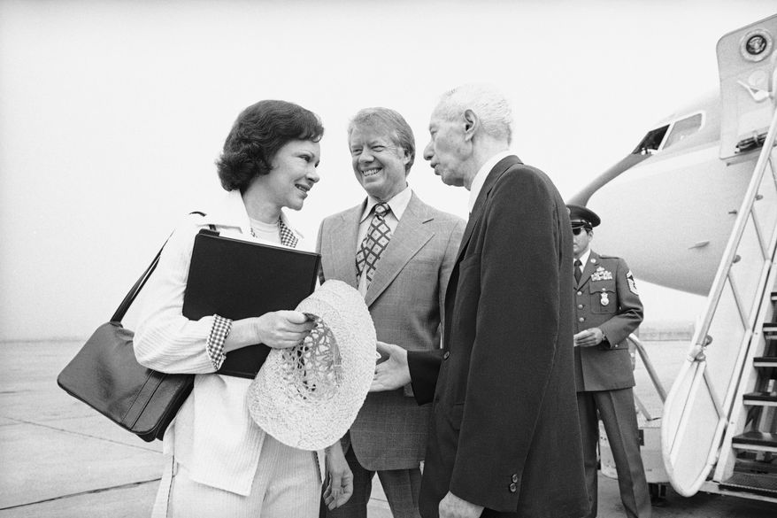 Admiral Hyman G. Rickover, right, greets President Jimmy Carter and first lady Rosalynn Carter at the Brunswick, Ga. Airport, May 27, 1977 as they departed for Port Canaveral, Fla., to tour and ride in the U.S.S. Los Angeles submarine.  The Carter family is staying at nearby St. Simons Island, Ga. during a working holiday vacation. (AP Photo/Charles Harrity)
