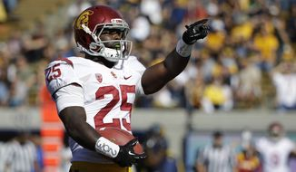USC running back Silas Redd celebrates after scoring a touchdown during the first quarter of an NCAA college football game against California Saturday, Nov. 9, 2013, in Berkeley, Calif. (AP Photo/Eric Risberg)