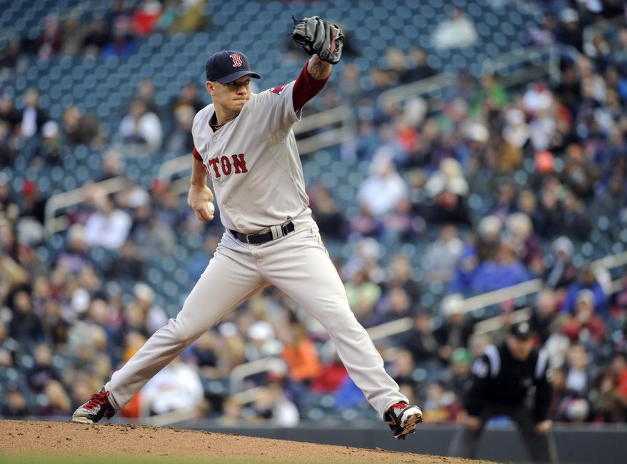 Boston Red Sox starting pitcher Jake Peavy throws against the Minnesota Twins during the first inning of a baseball game in Minneapolis, Tuesday, May, 13, 2014.(AP Photo/Craig Lassig)
