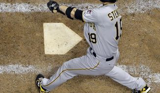 Pittsburgh Pirates' Chris Stewart hits an RBI single during the ninth inning of a baseball game against the Milwaukee Brewers Wednesday, May 14, 2014, in Milwaukee. (AP Photo/Morry Gash)