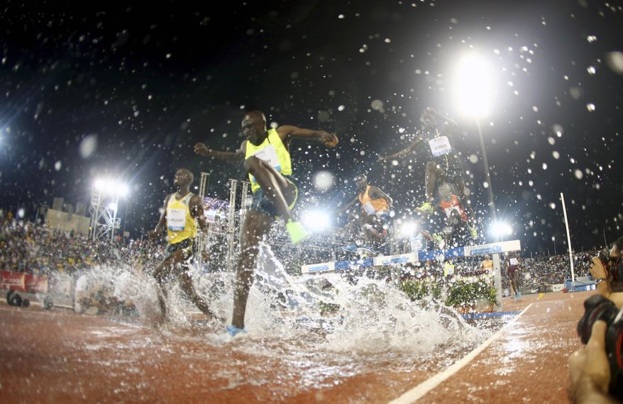 10ThingstoSeeSports - Athletes compete in the men's 3,000m steeplechase at the IAAF Diamond League in the Qatari capital Doha, Friday May 9, 2014. (AP Photo/Osama Faisal, File)