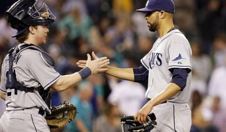Tampa Bay Rays starting pitcher David Price, right, is congratulated by catcher Ryan Hanigan after pitching a complete game victory over the Seattle Mariners in a baseball game Tuesday, May 13, 2014, in Seattle. The Rays won 2-1. (AP Photo)