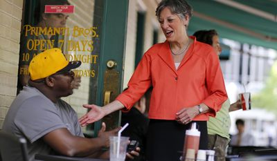 U.S. Rep. Allyson Schwartz, candidate for the Democratic gubernatorial nomination in Pennsylvania, right, visits with a lunch goer at Primanti's in Market Square in downtown Pittsburgh, Wednesday, May 14, 2014. (AP Photo)
