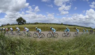 The pack pedals in the countryside during the fifth stage of the Giro d'Italia, Tour of Italy cycling race, from Taranto to Viggiano, Italy, Wednesday May 14, 2014. (AP Photo/Fabio Ferrari)