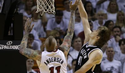 Brooklyn Nets forward Andrei Kirilenko (47) goes to the basket against Miami Heat forward Chris Andersen (11) during the first half of Game 5 of a second-round NBA playoff basketball game in Miami, Wednesday, May 14, 2014. (AP Photo)