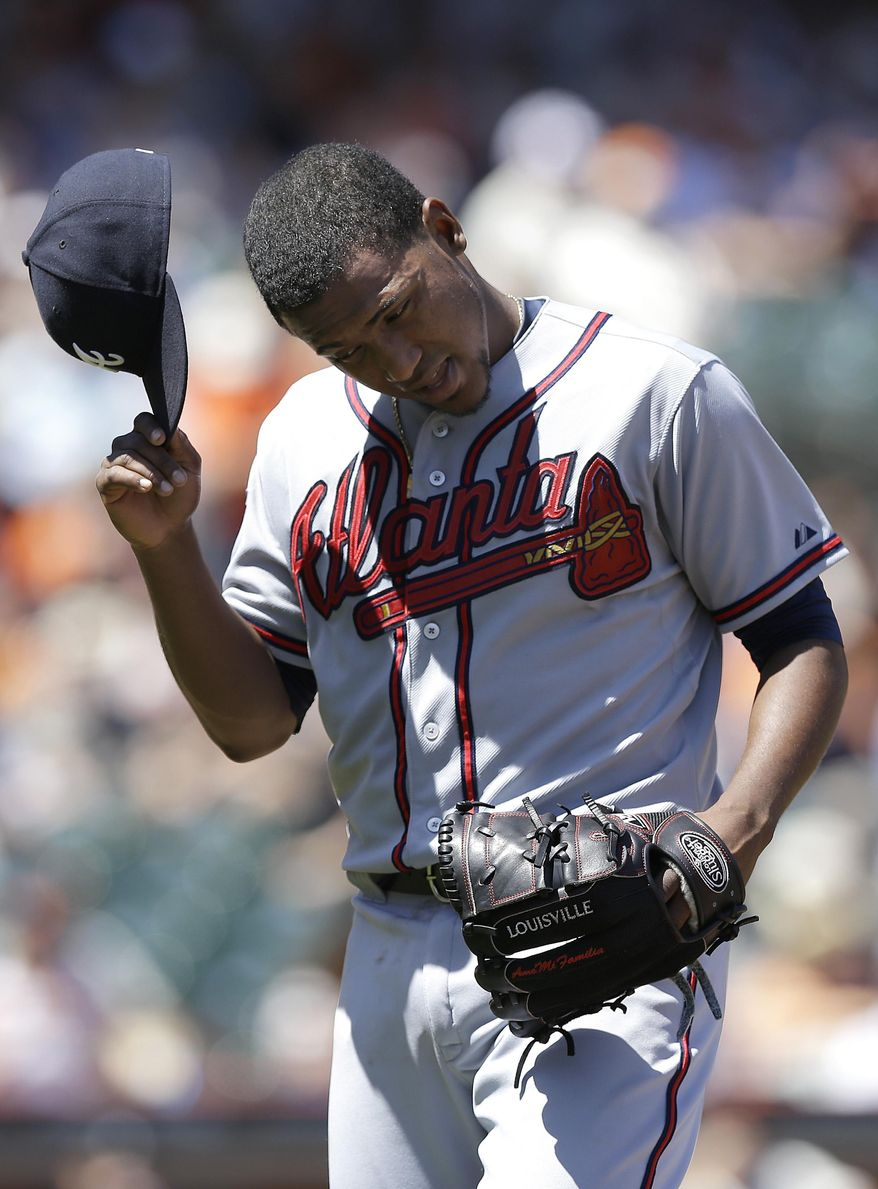 Atlanta Braves pitcher Julio Teheran walks off the mound after being relieved during the fourth inning of a baseball game against the San Francisco Giants in San Francisco, Wednesday, May 14, 2014. (AP Photo)